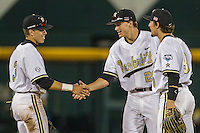 Vanderbilt Commodores outfielder Jeren Kendall (3) celebrates with teammates Bryan Reynolds (20) and Rhett Wiseman (8) after defeating the TCU Horned Frogs in Game 12 of the NCAA College World Series on June 19, 2015 at TD Ameritrade Park in Omaha, Nebraska. The Commodores defeated TCU 7-1. (Andrew Woolley/Four Seam Images)