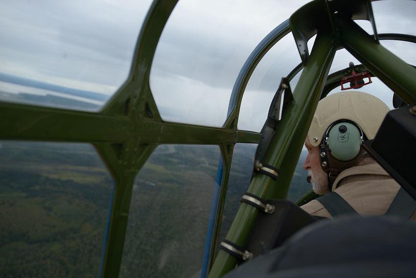 Gordon Bartel, a pilot with the Alaska Wing of the Commemorative Air Force at Merrill Field, flies a 1944 Vultee BT-13 over Anchorage.