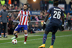 Atletico de Madrid´s Juanfran (L) and Olympiacos´s Masuaku during Champions League soccer match between Atletico de Madrid and Olympiacos at Vicente Calderon stadium in Madrid, Spain. November 26, 2014. (ALTERPHOTOS/Victor Blanco)