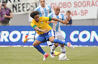 Brazil defender Marcelo (6) shields the ball from Argentina defender Clemente Rodriguez (15)  The Argentina National Team defeated Brazil 4-3 at MetLife Stadium, Saturday July 9 , 2012.