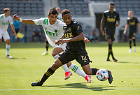 LOS ANGELES, CA - APRIL 17: Diego Palacios #12 of LAFC battles for a ball during a game between Austin FC and Los Angeles FC at Banc of California Stadium on April 17, 2021 in Los Angeles, California.