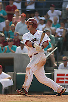 University of South Carolina Gamecocks 1st Baseman Christian Walker #13 hitting a 3-run homer in the bottom of the 8th inning during the 2nd and deciding game of the NCAA Super Regional vs. the University of Coastal Carolina Chanticleers on June 13, 2010 at BB&T Coastal Field in Myrtle Beach, SC.  The Gamecocks defeated Coastal Carolina 10-9 to advance to the 2010 NCAA College World Series in Omaha, Nebraska. Photo By Robert Gurganus/Four Seam Images