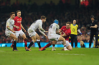 Pictured: Jack Nowell of England under pressure from George North of Wales during the Guinness six nations match between Wales and England at the Principality Stadium, Cardiff, Wales, UK.<br /> Saturday 23 February 2019