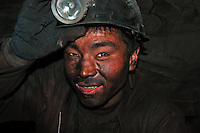 Coal mining worker inside the underground coal mine field in Wu Hai Xi, Inner Mongolia, China..