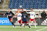 FOXBOROUGH, MA - OCTOBER 16: Thomas Roberts #23 of North Texas SC and Maciel #6 of New England Revolution II compete for a high ball during a game between North Texas SC and New England Revolution II at Gillette Stadium on October 16, 2020 in Foxborough, Massachusetts.