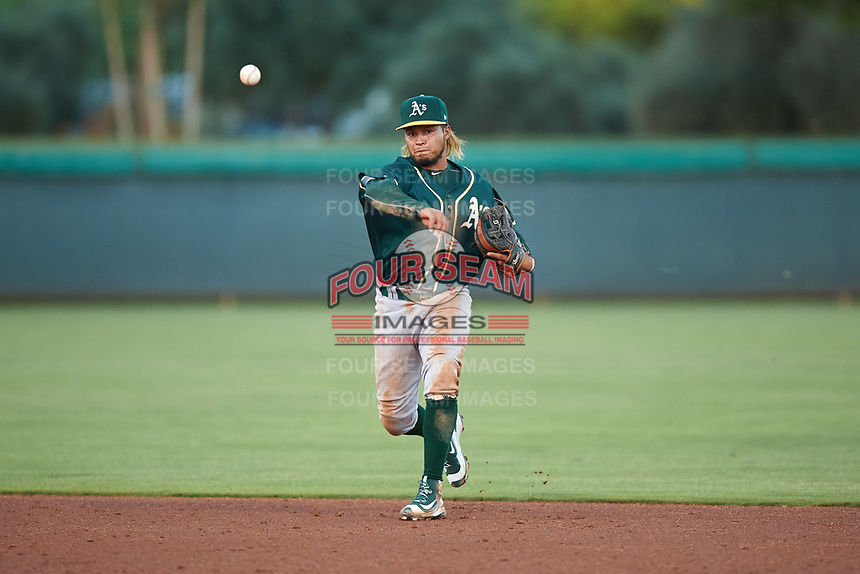 AZL Athletics Green second baseman Wilson Alvarez (3) throws to first base during an Arizona League game against the AZL Dodgers Lasorda at Camelback Ranch on June 19, 2019 in Glendale, Arizona. AZL Dodgers Lasorda defeated AZL Athletics Green 9-5. (Zachary Lucy/Four Seam Images)