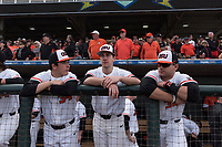 Oregon State Beavers teammates Christian Chamberlain (34), Andrew Walling (11), and Greg Fuchs (36) during a game against the New Mexico Lobos on February 15, 2019 at Surprise Stadium in Surprise, Arizona. Oregon State defeated New Mexico 6-5. (Zachary Lucy/Four Seam Images)