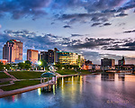 Dayton Ohio skyline at dusk with river. Cityscape photo with skyline of Dayton and Riverscape of Five Metro Parks. Photo by Robin Feld Photography