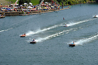 The T & S boats speed past the pits.