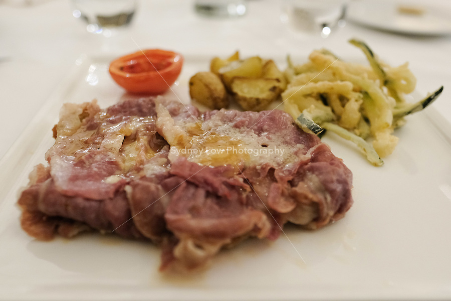 The main course of Bolognese veal chop cutlet (with proscuitto and cheese) € 22 at Pappagallo, Bologna. The Pappagallo Restaurant in Bologna was established in 1919. It continues to serve traditional Bolognese cuisine. Photo Sydney Low