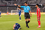 FIFA Referee Mohd Amirul Izwan of Malaysia (C) gestures as Nagatomo Yuto of Japan (R) lies on the pitch during the AFC Asian Cup UAE 2019 Group F match between Oman (OMA) and Japan (JPN) at Zayed Sports City Stadium on 13 January 2019 in Abu Dhabi, United Arab Emirates. Photo by Marcio Rodrigo Machado / Power Sport Images