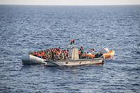 Sea Watch-2.<br /> Die Sea Watch-2 bei ihrer 13. SAR-Mission vor der libyschen Kueste.<br /> Im Bild: Ein Schlauchboot mit ca. 160 Menschen wird von der Sea Watch-Crew mit Rettungswesten versorgt.<br /> Die Aktion wird von einem Boot das sich als libysche Kuestenwache ausgibt unterstuetzt.<br /> 20.10.2016, Mediterranean Sea<br /> Copyright: Christian-Ditsch.de<br /> [Inhaltsveraendernde Manipulation des Fotos nur nach ausdruecklicher Genehmigung des Fotografen. Vereinbarungen ueber Abtretung von Persoenlichkeitsrechten/Model Release der abgebildeten Person/Personen liegen nicht vor. NO MODEL RELEASE! Nur fuer Redaktionelle Zwecke. Don't publish without copyright Christian-Ditsch.de, Veroeffentlichung nur mit Fotografennennung, sowie gegen Honorar, MwSt. und Beleg. Konto: I N G - D i B a, IBAN DE58500105175400192269, BIC INGDDEFFXXX, Kontakt: post@christian-ditsch.de<br /> Bei der Bearbeitung der Dateiinformationen darf die Urheberkennzeichnung in den EXIF- und  IPTC-Daten nicht entfernt werden, diese sind in digitalen Medien nach §95c UrhG rechtlich geschuetzt. Der Urhebervermerk wird gemaess §13 UrhG verlangt.]