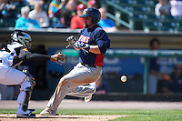 Toledo Mudhens designated hitter Casey McGehee (31) slides home as catcher Carlos Paulino waits for a throw during a game against the Rochester Red Wings on June 12, 2016 at Frontier Field in Rochester, New York.  Rochester defeated Toledo 9-7.  (Mike Janes/Four Seam Images)