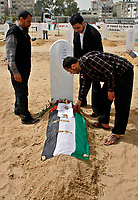 """A Palestinian man works at a fake cemetery to represent the diminishing number of factories in Gaza, during a protest calling for an end of the Israeli siege to the Gaza Strip March 18, 2008.""""photo by Fady Adwan"""""""