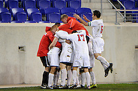 Walter Hines (19) of the St. John's Red Storm celebrates scoring with teammates . St. John's defeated Villanova 2-0 during the second semifinal match of the Big East Men's Soccer Championships at Red Bull Arena in Harrison, NJ, on November 11, 2011.