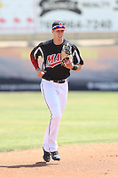 Ryan Cordell (9) of the High Desert Mavericks returns to the dugout during a game against the Bakersfield Blaze at Mavericks Stadium on May 18, 2015 in Adelanto, California. High Desert defeated Bakersfield, 7-6. (Larry Goren/Four Seam Images)