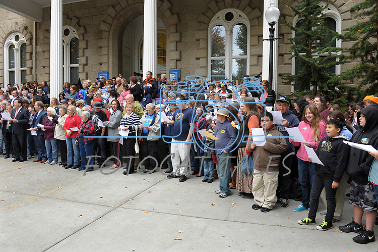 """Hundreds sing on the Capitol steps Thursday, Oct. 30, 2014 during #NevadaSings!, a statewide sing-a-long of """"Home Means Nevada."""" Approximately 370 people took part  in the Carson City portion of the event, which seeks to establish a new record for the most people in an American state to sing their state song at the same time."""
