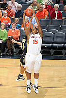 Nov. 14, 2010; Charlottesville, VA, USA; Virginia guard Ariana Moorer (15) grabs a rebound in front of Mount St. Mary's guard Ashley Christie (14) during the game at the John Paul Jones Arena. Virginia won 81-58. Mandatory Credit: Andrew Shurtleff
