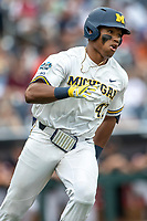 Michigan Wolverines designated hitter Jordan Nwogu (42) runs to first base during Game 1 of the NCAA College World Series against the Texas Tech Red Raiders on June 15, 2019 at TD Ameritrade Park in Omaha, Nebraska. Michigan defeated Texas Tech 5-3. (Andrew Woolley/Four Seam Images)