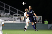 CARY, NC - AUGUST 01: Robert Kristo #11 beats Jake Rufe #13 to a header during a game between Birmingham Legion FC and North Carolina FC at Sahlen's Stadium at WakeMed Soccer Park on August 01, 2020 in Cary, North Carolina.