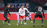 Mariusz Lewandowski of Poland is defended by Michael Bradley and Ricardo Clark of the USA. The United States defeated Poland 3-0 during an international friendly at Wisla Stadium in Krakow, Poland on March 26, 2008.