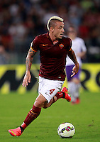 Calcio, Serie A: Roma vs Fiorentina. Roma, stadio Olimpico, 30 agosto 2014.<br /> Roma midfielder Radja Nainggolan, of Belgium, in action during the Italian Serie A football match between AS Roma and Fiorentina at Rome's Olympic stadium, 30 August 2014.<br /> UPDATE IMAGES PRESS/Isabella Bonotto