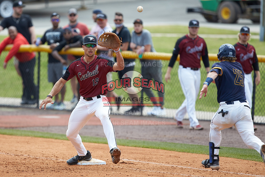 North Carolina Central Eagles first baseman Justin Bowers (19) waits for a throw as Ryne Stanley (25) of the North Carolina A&T Aggies hustles down the line at Durham Athletic Park on April 10, 2021 in Durham, North Carolina. (Brian Westerholt/Four Seam Images)