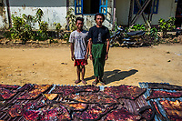 Two men suspected of being wild elephant poachers stand for photo documentation, together with the slices of dried elephant skin found with them, at the police station in Ngwe Saung. At least 115 wild elephants have been slaughtered by poachers within the past five years in the dense jungles of Irrawaddy, Pegu Range (Bago Yoma), and the periphery of Yangon region, with a record high of 59 in 2017. This sudden spike led to increased support to the country's national plan to protect elephants and strengthened the response from the Myanmar government, international organizations such as WWF, and local CSOs. Campaigns such as Voice for Momos have been organized, and training has been given to forestry staff, mahouts, and the rangers of Myanmar's Emergency Elephant Response Unit. The increased anti-poaching patrols led to 15 arrests of poachers in 2017.