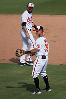 Baltimore Orioles third baseman Rylan Bannon (39) throws the ball back to the pitcher with shortstop Mason McCoy (82) looking on during a Major League Spring Training game against the Philadelphia Phillies on March 12, 2021 at the Ed Smith Stadium in Sarasota, Florida.  (Mike Janes/Four Seam Images)