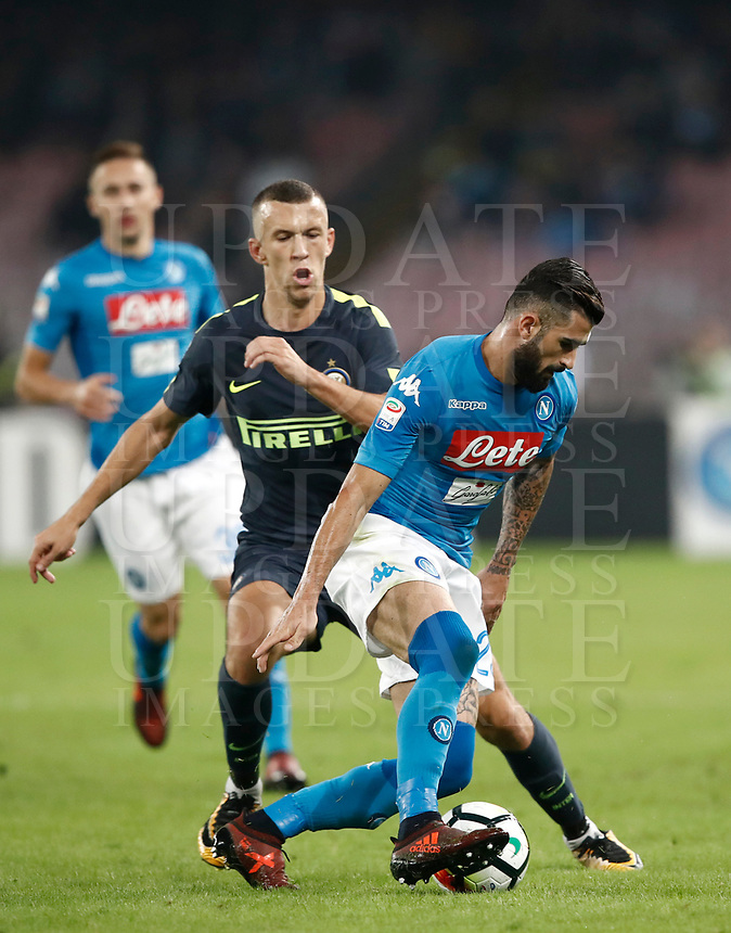 Calcio, Serie A: Napoli, stadio San Paolo, 21 ottobre 2017.<br /> Napoli's Elseid Hysaj (r) in action with Inter's Ivan Perisic (l) during the Italian Serie A football match between Napoli and Inter at Napoli's San Paolo stadium, October 21, 2017.<br /> UPDATE IMAGES PRESS/Isabella Bonotto