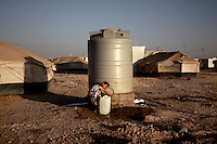 A young girl fills a jerry can with water. Approximately two million people have fled the conflict in Syria. At least 130,000 of them live in Zaatari Refugee Camp, although it was designed to house 60,000, and a further 2,000 people arrive each day.