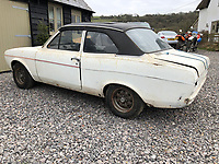 BNPS.co.uk (01202) 558833. <br /> Pic: Charterhouse/BNPS<br /> <br /> Pictured: The RS2000. <br /> <br /> A clapped-out Ford Escort which has been languishing in a garage for nearly 25 years is tipped to sell for £25,000.<br /> <br /> The rare 1975 Mk 1 RS2000 model is in a rusty state and is in need of lots of care and attention.
