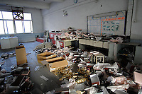 "The ransacked store-room of the  Dingfu Factory in Houjie Town, Dongguan, China. A sign outside the factory that made shoes for Zara and Nine West amongst others, reads that the ""Dongguan People's Court have closed the factory"". As the economy changes and Chinese labour gets more expensive, factories are closing leaving ghost towns behind them..20 Dec 2007"