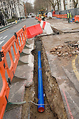 Contractors carry out works in Holborn, central London, to replace the capital's Victorian water mains.