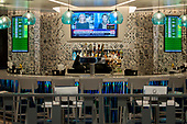 A restaurant is empty of customers at the arrivals gate at the international terminal at Dulles International Airport in Dulles, Va., Monday, March16, 2020. Some people are taking the precaution of wearing face masks as they arrive to be greeted by family and or friends. Credit: Rod Lamkey / CNP
