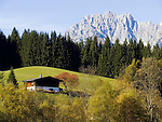 Austria, Tyrol, Kaiserwinkl: Tyrolean farm house and Wilder Kaiser mountains