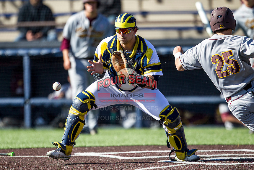 Michigan Wolverines catcher Harrison Wenson (7) waits for a throw from the outfield against the Central Michigan Chippewas on March 29, 2016 at Ray Fisher Stadium in Ann Arbor, Michigan. Michigan defeated Central Michigan 9-7. (Andrew Woolley/Four Seam Images)