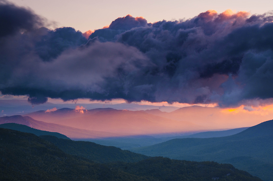 Crepuscular Rays at sunrise in the astern White Mountains of New Hampshire.