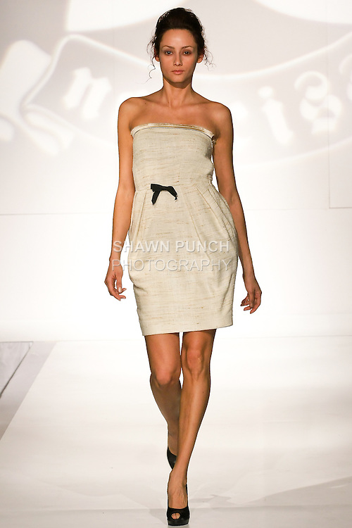 Model walks the runway in an outfit by Alise Trautmane, for the Narciss Spring 2011 fashion show, during Nolcha Fashion Week, September 13, 2010.