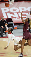 Arkansas forward Erynn Barnum (left) flips the ball up to the basket Thursday, Feb. 11, 2021, as she is fouled by Mississippi State center Jessika Carter (right) during the first half of play in Bud Walton Arena. Visit nwaonline.com/210212Daily/ for today's photo gallery. <br /> (NWA Democrat-Gazette/Andy Shupe)