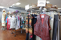 Rows clothing are visible Friday, July 30, 2021, at the Northwest Medical Center Auxiliary Thrift Shop in Springdale. The store, located at 802 Quandt Avenue, is have a $1 sale on summer seasonal clothing items to make room for fall and winter merchandise. Check out nwaonline.com/210731Daily/ and nwadg.com/photos for a photo gallery.(NWA Democrat-Gazette/David Gottschalk)