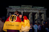 Berlin, Germany<br /> October 3, 1990<br /> <br /> Large crowds of East and West Germans gathered at the Brandenburg Gate to celebrate the reunification of East and West Germany, nearly one year after the Berlin Wall was opened allowing East Germans to travel freely to the West. By October 1990 almost nothing remained of the wall.