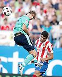 Atletico de Madrid's Raul Garcia against Barcelona's Maxwell during La liga match. September 19, 2010. (ALTERPHOTOS/Alvaro Hernandez).