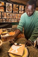 Malian-Senegalese Artist Boubacar Dia Demonstrates his Sand-Painting Technique.  Goree Island, Dakar, Senegal. Model released.