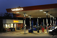 Sainsbury's Petrol station at night in Merthyr Tydfil, Wales, UK