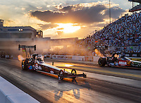 Sep 16, 2016; Concord, NC, USA; NHRA top fuel driver Scott Palmer (left) races alongside Terry McMillen during qualifying for the Carolina Nationals at zMax Dragway. Mandatory Credit: Mark J. Rebilas-USA TODAY Sports