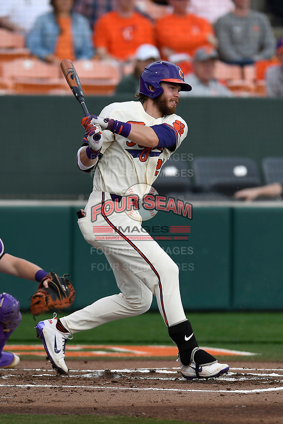 Right fielder Seth Beer (28) of the Clemson Tigers bats in a game against the Furman Paladins on Tuesday, February 20, 2018, at Doug Kingsmore Stadium in Clemson, South Carolina. Clemson won, 12-4. (Tom Priddy/Four Seam Images)