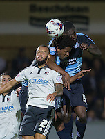 Anthony Stewart (right) of Wycombe Wanderers, Sido Jombati (centre) of Wycombe Wanderers and Ashley 'Jazz' Richards of Fulham go up for the ball during the Capital One Cup match between Wycombe Wanderers and Fulham at Adams Park, High Wycombe, England on 11 August 2015. Photo by Andy Rowland.