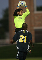 Andrew Quinn #0 of the University of Notre Dame pulls in the ball over Latif Alashe #21 of the University of Michigan during a men's NCAA match at the new Alumni Stadium on September 1 2009 in South Bend, Indiana. Notre Dame won 5-0.
