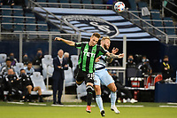 KANSAS CITY, KS - MAY 9: Zan Kolmanic #21 Austin FC goes up for a header with Johnny Russell #7 Sporting KC during a game between Austin FC and Sporting Kansas City at Children's Mercy Park on May 9, 2021 in Kansas City, Kansas.